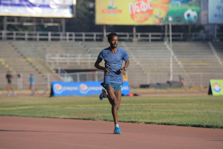 An Ethiopian running in stadium/meskel square